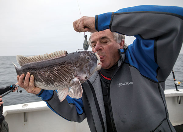Captain Bob Cope kissing tautog