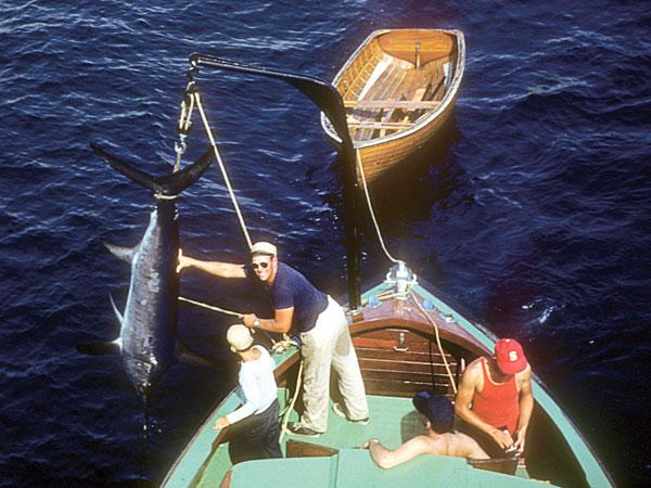 Nelson Blount swings a swordfish on board