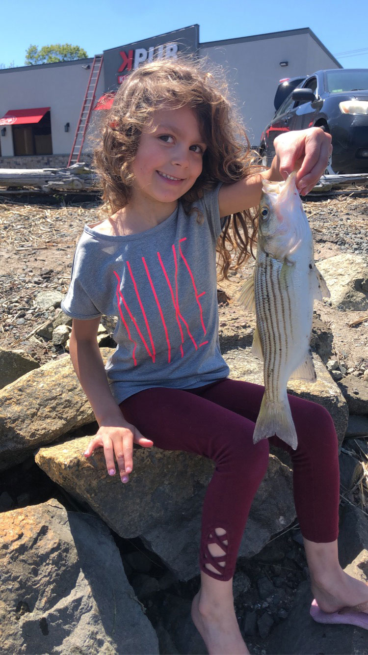 Layla DeVincent first striped bass