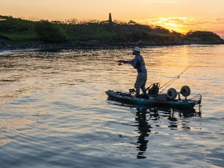kayak angler at sunset