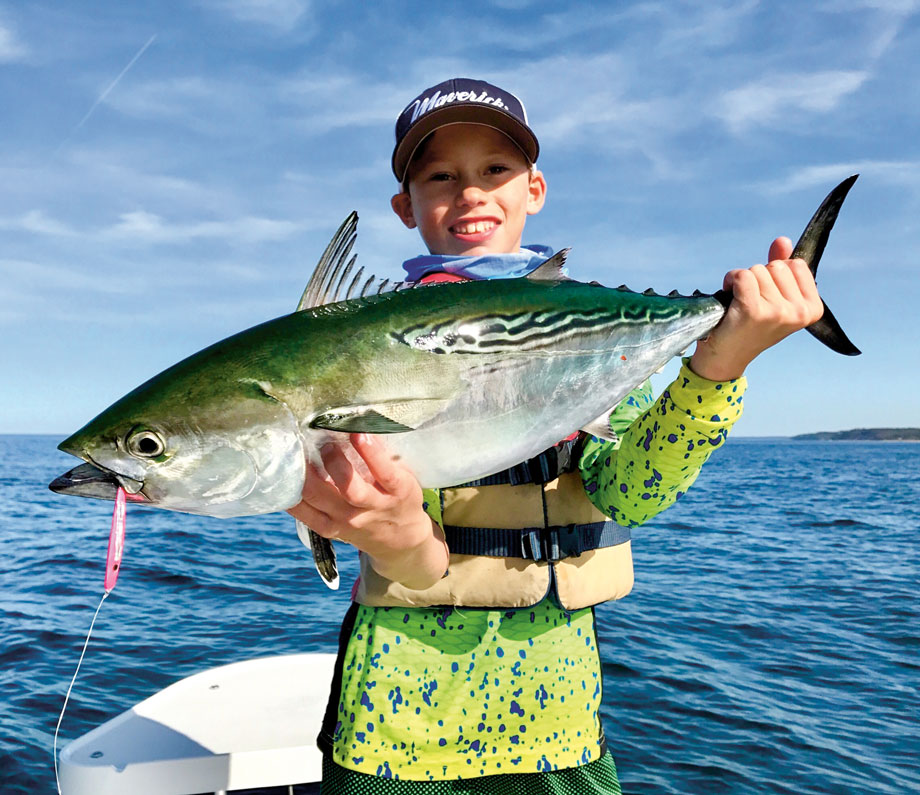young angler with false albacore