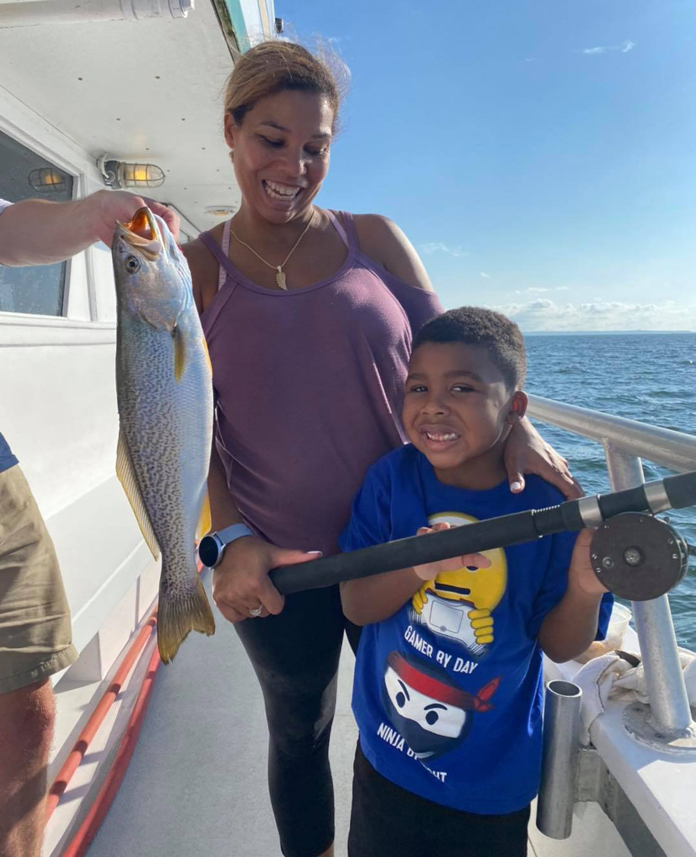 Carter and his mom weakfish
