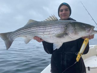 Max Kristiansen with a nice topwater striped bass.