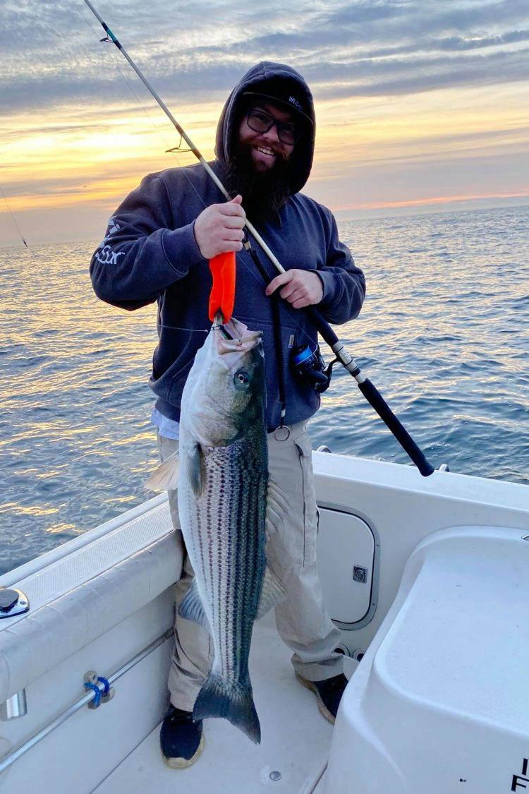 Corey Vafiadis with one of the many stripers he caught off Long Branch last Friday.
