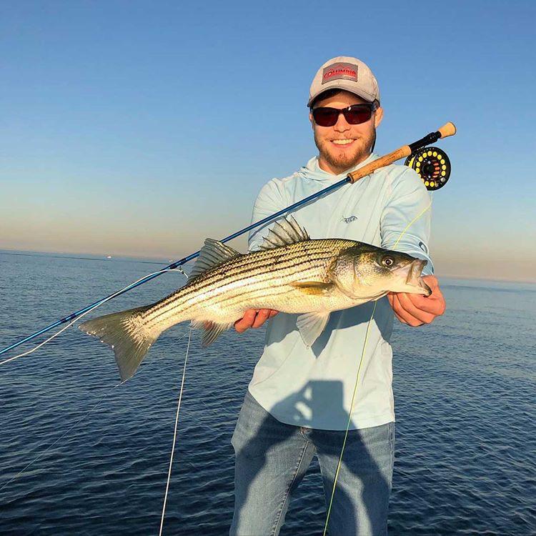 Garrett Lambert with a golden hour bass caught on Capt. Dave Flanagan's boat.