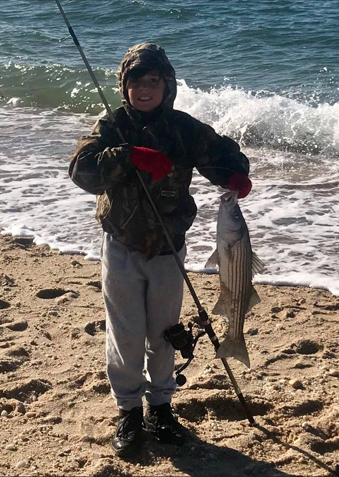 Michael DeNicola with a 26-inch late-season schoolie caught from a North Fork, Long Island beach.