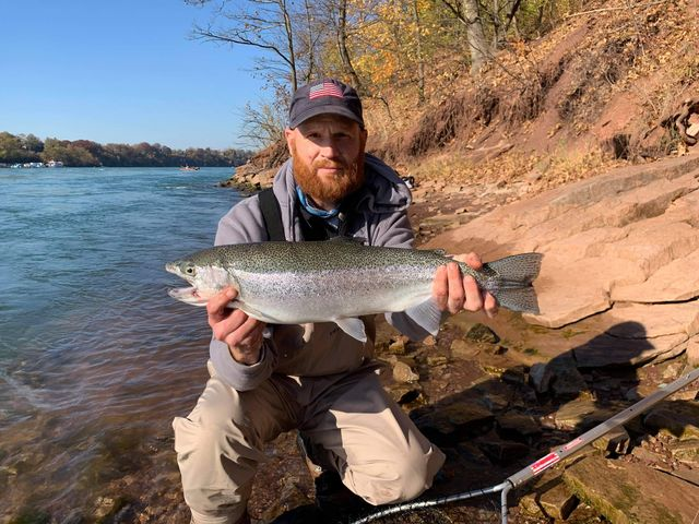 Wade Rowcliffe of Rochester with a lower Niagara River steelhead he caught over the weekend on a faded 8mm yellow bead.