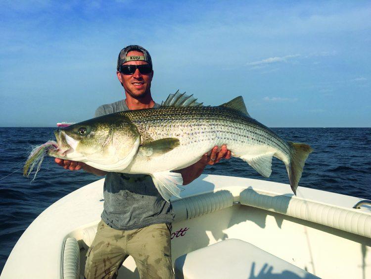 Captain Jason Dapra of Blitz Bound Charters put his client, Jesse, on a 54-pound fly rod striper.