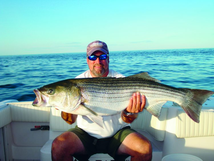 Captain Stu Patterson located bunker schools in open Long Island Sound and found his personal best striper hounding those baitfish.