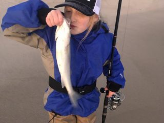Rosie Wetzel with a schoolie bass.
