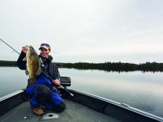A winter smallmouth bass guide detailing the best places to find them at lakes, what lures to use, techniques, tackle, and more.