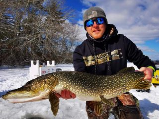 Mike Kelley holds a tournament winning northern pike.