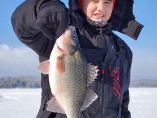 Adam fishing with TimMooreOutdoors
