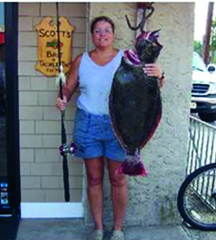Monica Oswald holding a gigantic 24.2-pound fluke caught off Monmouth County, New Jersey.